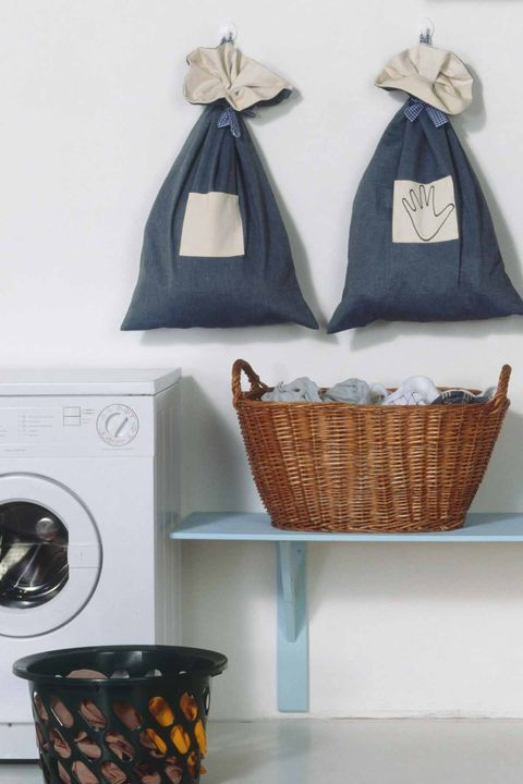 Laundry Room Organization - hang your ironing boards - Use Pretty Bins And Baskets