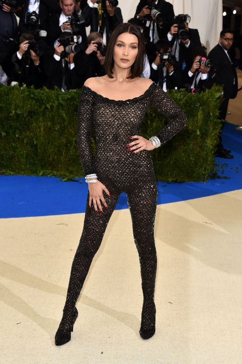 Fashion, Clothing, Fashion model, Shoulder, Thigh, Leg, Red carpet, Tights, High heels, Footwear,