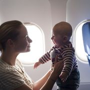 Skin, Child, Toddler, Fun, Car seat, Photography, Vacation, Baby, Reflection, Air travel,
