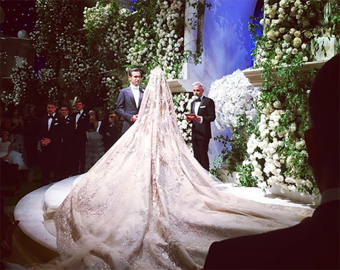 Wedding dress, Bride, Gown, Dress, Photograph, Bridal veil, White, Veil, Bridal accessory, Bridal clothing,