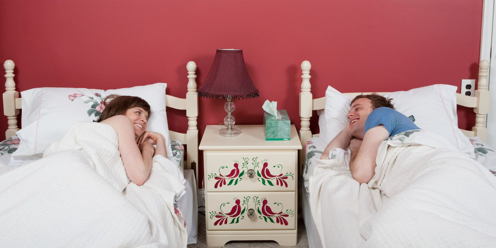 husband and wife sleeping in separate rooms