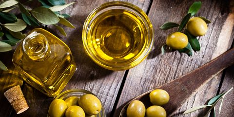 Olive, Fruit, Food, Extra virgin olive oil, Cooking oil, Lemon, Plant, Olive oil, Ingredient, Vegetable oil,
