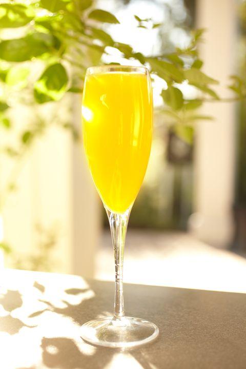 Drink, Champagne cocktail, Alcoholic beverage, Non-alcoholic beverage, Juice, Cocktail, Glass, Mimosa, Stemware, Distilled beverage,