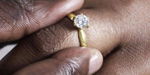Ring, Finger, Engagement ring, Yellow, Wedding ring, Jewellery, Fashion accessory, Hand, Diamond, Wedding ceremony supply,