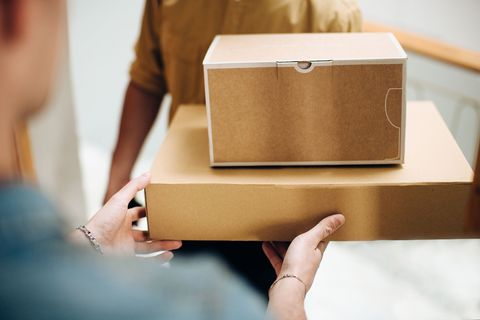 Box, Package delivery, Hand, Cardboard, Material property, Paper product, Packaging and labeling, Carton, Paper, Present,