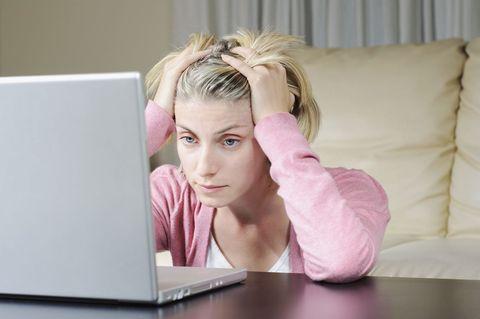 woman staring at hacked computer
