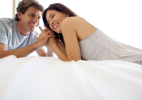 couple in their 40s in bed