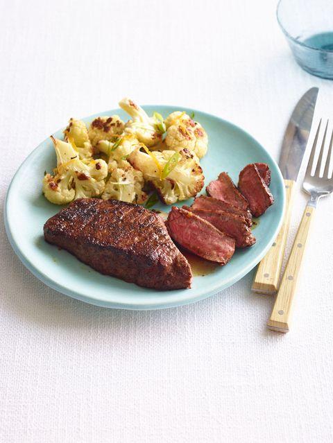 steak with orange roasted cauliflower and scallions