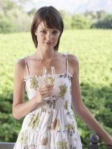 woman in floral dress in field