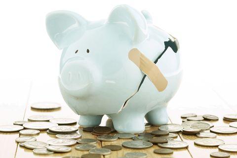 broken piggy bank with loose change