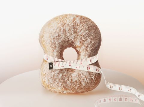 tape measure squeezing a donut
