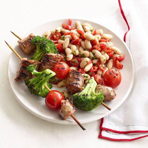 sausage kebabs with broccoli tomatoes and white bean salad