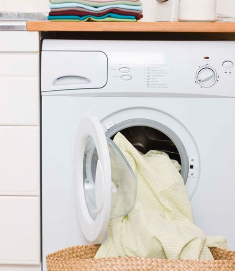 white clothes dryer with yellow towels hanging out