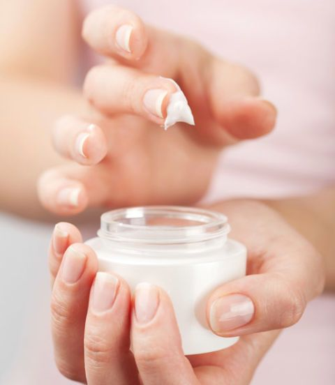 woman hands cream container