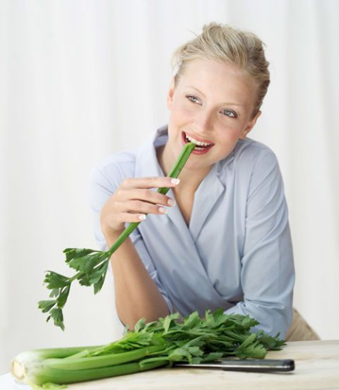 woman eating celery