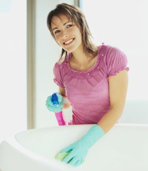 woman cleaning a bathtub