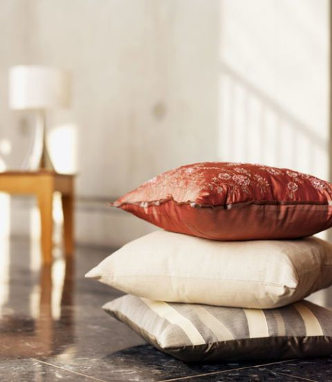 pillows stacked on the floor