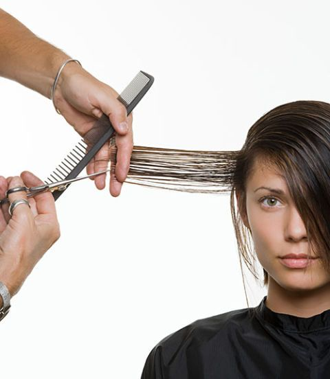 woman getting hair cut