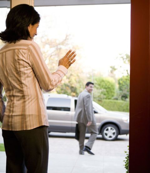 woman waving goodbye to her husband