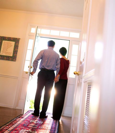 couple at an open door