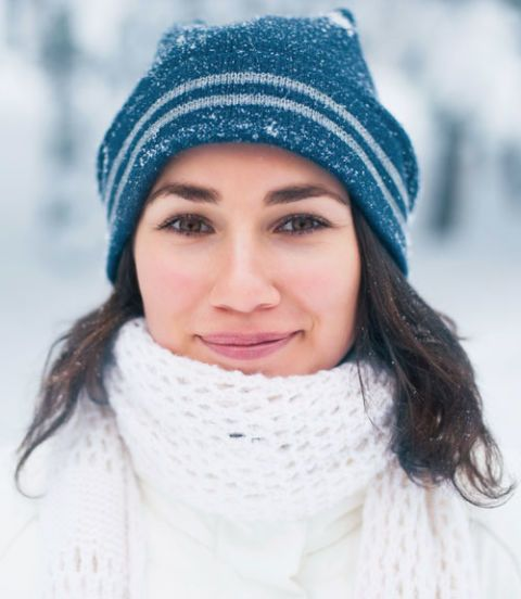 woman in a hat and scarf