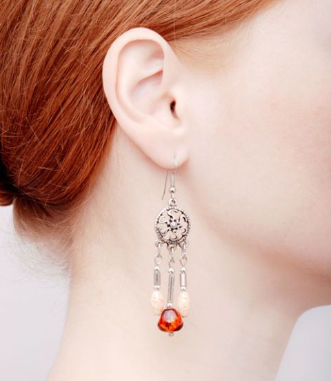 woman with long earrings