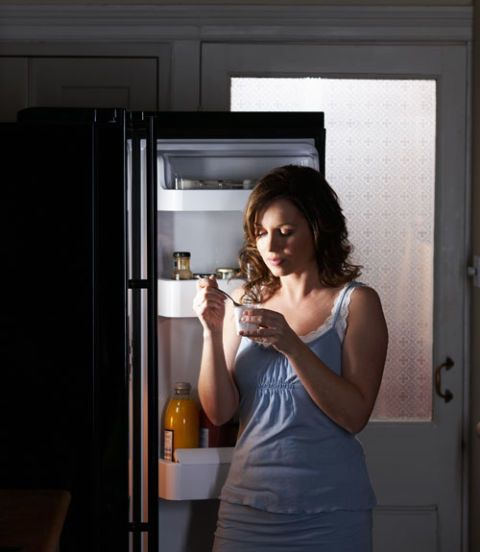 woman eating a nighttime snack