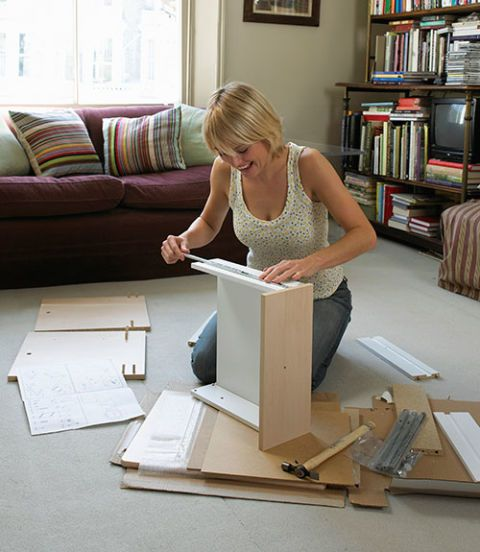 woman assembling furniture