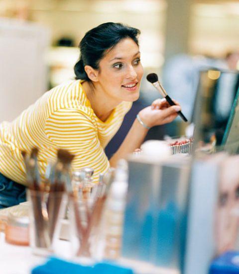 woman testing bronzer