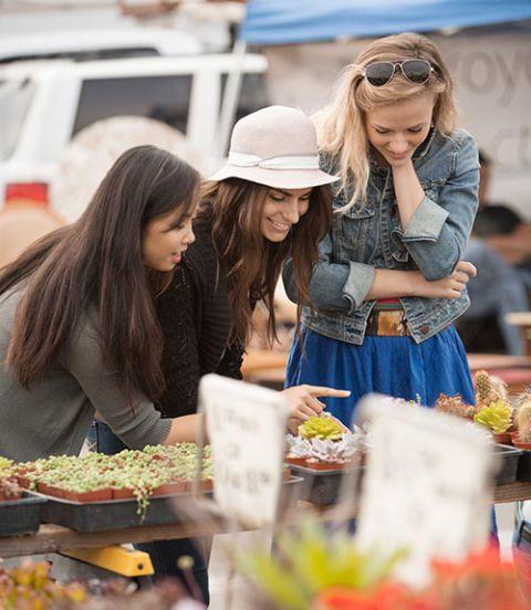 women shopping at flea market