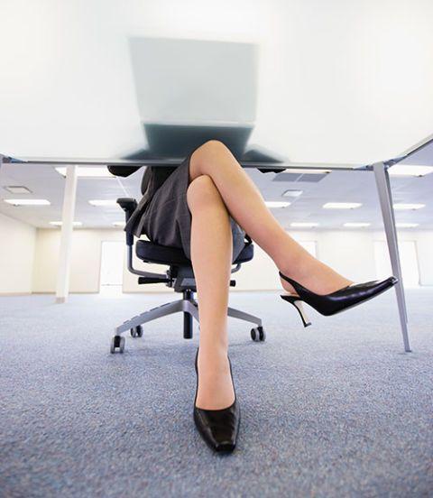 woman sitting cross legged on chair