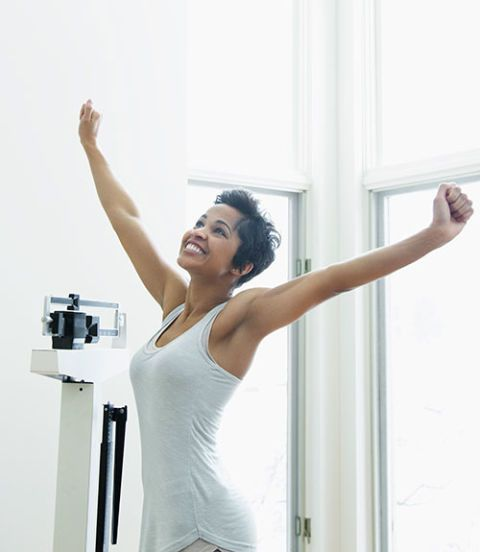 woman happy on the scale