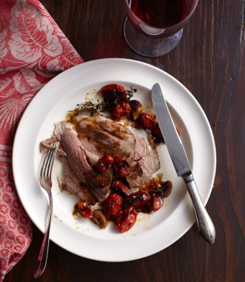 Orange and cumin leg of lamb with roasted tomatoes and garlic recipe image forumfinder Choice Image