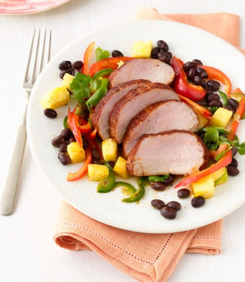 """<p>This dish delivers a lot of filling flavor—and at a surprising 348 calories per serving no less. In summer, take it to the grill, cooking the pork over medium-high heat for about 18 minutes.</p> <p><strong><a target=""""_blank"""" href=""""http://www.womansday.com/food-recipes/food-drinks/recipes/a11709/barbecue-rubbed-pork-tenderloin-with-pineapple-salad-recipe/"""">Get the recipe.</a></strong></p>"""