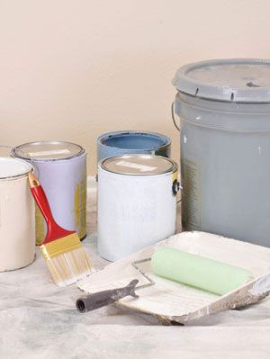buckets of paint inside home
