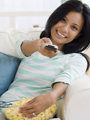 woman enjoying TV