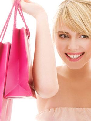 woman with all of her pink breast-cancer fighting products
