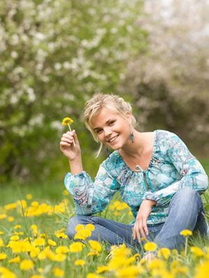 woman in floral shirt in field