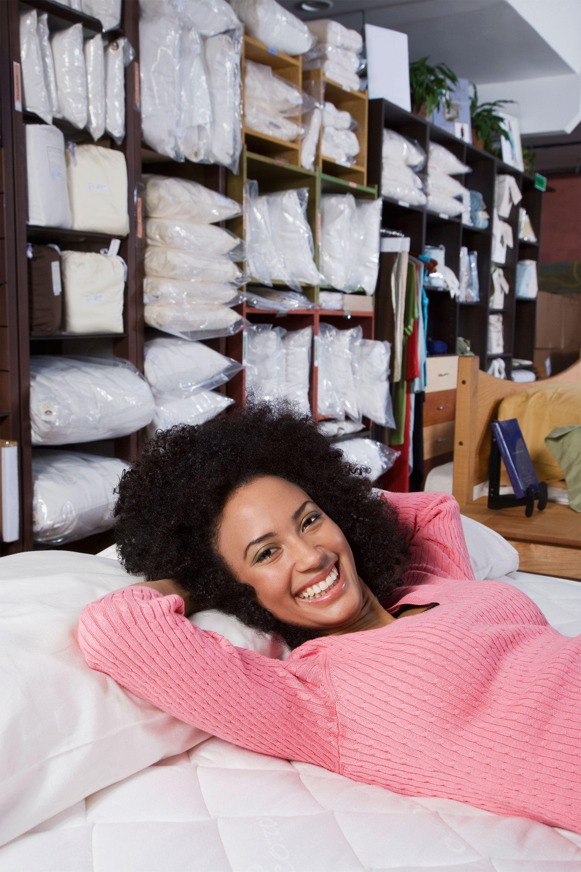 woman testing out mattress