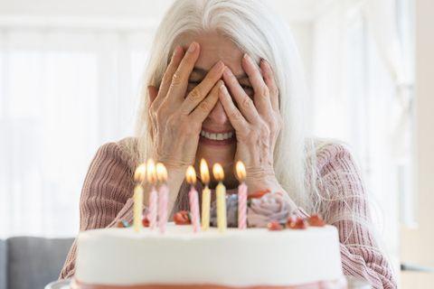 Finger, Cake, Birthday candle, Lighting, Sweetness, Dessert, Baked goods, Ingredient, Food, Cake decorating,