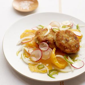 """<p>A more affordable alternative to crab cakes, these delectably crunchy cod cakes are coated in panko bread crumbs and served with a fresh citrus salad—which pairs equally well with seared or poached fish.</p> <p><a target=""""_blank"""" href=""""http://www.womansday.com/food-recipes/food-drinks/recipes/a11757/cod-cakes-orange-radish-salad-recipe-122914/""""><strong>Get the recipe.</strong></a></p> <p><!--EndFragment--></p>"""