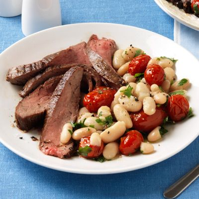 flank steak with tomatoes and white beans