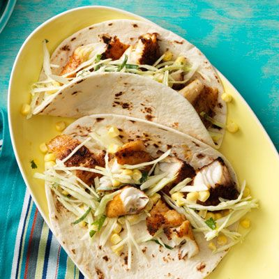 spicy fish tacos with creamy cabbage and corn slaw