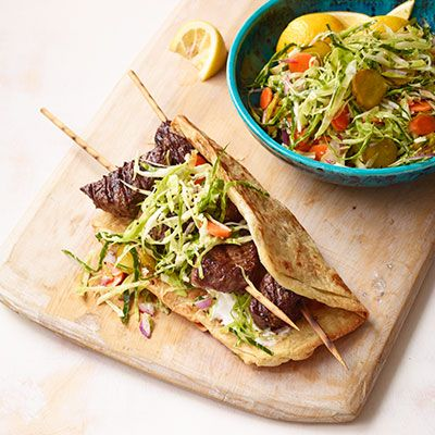 kebabs with cabbage carrot and pickle slaw