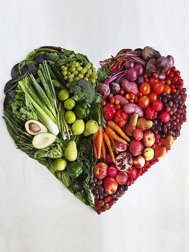 fruits and vegetables in the shape of a heart