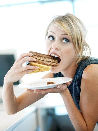 woman eating cake