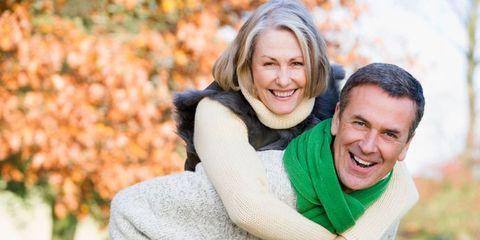 older couple on a piggyback ride