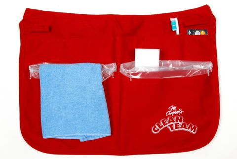 red apron with cleaning supplies
