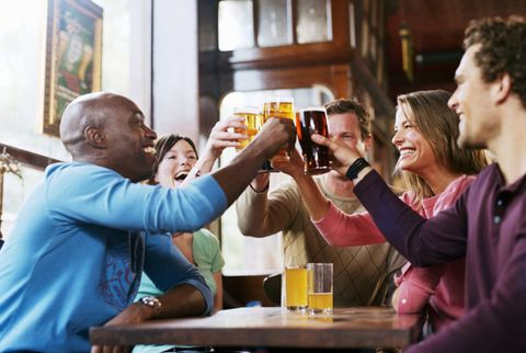 men hanging out at a bar