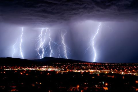 lightning in a night sky over a town